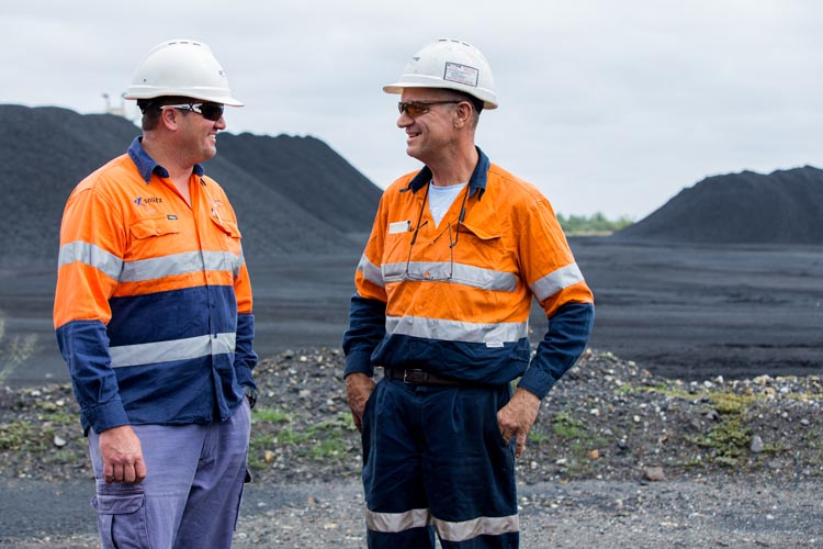 Two workers talking onsite